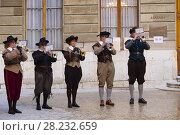 Купить «Group of musicians at the town hall, Fête de l'Escalade. Traditional festival Escalade ceremony is held every year on December 11th and 12th, Old town, historic center. Geneva. Switzerland, Europe.», фото № 28232659, снято 9 декабря 2017 г. (c) age Fotostock / Фотобанк Лори