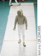 Купить «Boy teenager fencer in special costume at the fencing competition with rapier», фото № 28234695, снято 26 марта 2018 г. (c) Константин Шишкин / Фотобанк Лори