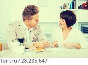 Купить «Man and woman work with papers», фото № 28235647, снято 17 октября 2018 г. (c) Яков Филимонов / Фотобанк Лори