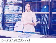 Купить «friendly female seller demonstrating shirts in men's cloths store», фото № 28235771, снято 16 июля 2018 г. (c) Яков Филимонов / Фотобанк Лори