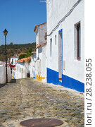 Купить «Cozy narrow paved streets with white houses inside the old city walls of Mertola. Beja. Portugal», фото № 28238055, снято 30 июня 2016 г. (c) Serg Zastavkin / Фотобанк Лори
