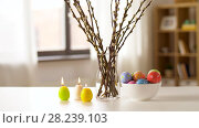 Купить «easter eggs, willow and candles burning at home», видеоролик № 28239103, снято 28 марта 2018 г. (c) Syda Productions / Фотобанк Лори