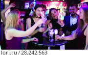 Купить «Colleagues dancing on corporate party with cocktails in hands», видеоролик № 28242563, снято 4 мая 2017 г. (c) Яков Филимонов / Фотобанк Лори