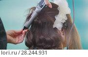Купить «Professional hairstylist making curly hair for beautiful woman», фото № 28244931, снято 24 апреля 2018 г. (c) Константин Шишкин / Фотобанк Лори
