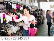 Купить «Woman choosing sexy silky bra», фото № 28245707, снято 24 октября 2018 г. (c) Яков Филимонов / Фотобанк Лори
