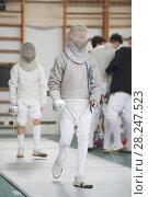 Купить «Young fencer at the fencing competition with sword and mask», фото № 28247523, снято 26 марта 2018 г. (c) Константин Шишкин / Фотобанк Лори