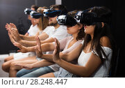 Woman watching exciting movie with VR glasses. Стоковое фото, фотограф Яков Филимонов / Фотобанк Лори