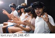 Купить «Excited man experiencing with friends virtual reality», фото № 28248451, снято 6 июля 2017 г. (c) Яков Филимонов / Фотобанк Лори