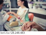 Купить «Woman hands receiving manicure», фото № 28248483, снято 28 апреля 2017 г. (c) Яков Филимонов / Фотобанк Лори