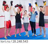 Купить «Portrait of females and males training in boxing gloves», фото № 28248543, снято 5 мая 2017 г. (c) Яков Филимонов / Фотобанк Лори