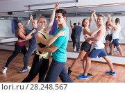 Купить «Group of energy people dancing salsa together», фото № 28248567, снято 10 ноября 2018 г. (c) Яков Филимонов / Фотобанк Лори