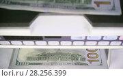 Купить «Electronic money counter machine is counting is counting the American hundred-dollar US dollars banknotes», видеоролик № 28256399, снято 31 января 2010 г. (c) Куликов Константин / Фотобанк Лори