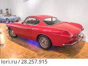 Купить «Серийный красный спортивный двухдверный автомобиль Volvo P1800S с кузовом купе, выпускавшийся компанией Volvo Cars в 1963—1970 годах», фото № 28257915, снято 27 марта 2018 г. (c) Владимир Сергеев / Фотобанк Лори