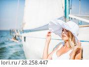 Купить «girl in white broad-brimmed hat near sailing yacht», фото № 28258447, снято 25 июля 2017 г. (c) katalinks / Фотобанк Лори