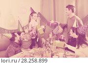 Купить «Large family presenting gifts to girl during birthday party», фото № 28258899, снято 25 мая 2018 г. (c) Яков Филимонов / Фотобанк Лори