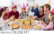 Купить «Cheerful family members saying toasts», фото № 28258911, снято 16 августа 2018 г. (c) Яков Филимонов / Фотобанк Лори