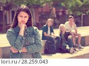 Купить «Outcasted teenage girl outdoors», фото № 28259043, снято 17 июля 2018 г. (c) Яков Филимонов / Фотобанк Лори