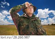 Купить «soldier or traveler in military uniform over sky», фото № 28260987, снято 14 августа 2014 г. (c) Syda Productions / Фотобанк Лори