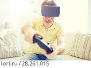 Купить «man in virtual reality headset with controller», фото № 28261015, снято 12 марта 2016 г. (c) Syda Productions / Фотобанк Лори
