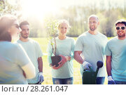 Купить «group of volunteers with tree seedling in park», фото № 28261047, снято 7 мая 2016 г. (c) Syda Productions / Фотобанк Лори