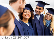 Купить «happy students or bachelors in mortar boards», фото № 28261067, снято 24 сентября 2016 г. (c) Syda Productions / Фотобанк Лори