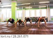 Купить «group of people doing push-ups in gym», фото № 28261071, снято 19 февраля 2017 г. (c) Syda Productions / Фотобанк Лори