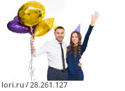 Купить «happy couple with party caps and balloons», фото № 28261127, снято 3 марта 2018 г. (c) Syda Productions / Фотобанк Лори
