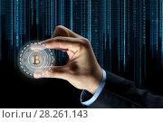 Купить «close up of businessman hand with bitcoin hologram», фото № 28261143, снято 6 сентября 2016 г. (c) Syda Productions / Фотобанк Лори