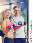Купить «smiling young woman with personal trainer in gym», фото № 28261155, снято 29 июня 2014 г. (c) Syda Productions / Фотобанк Лори