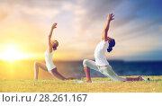 Купить «couple making yoga low lunge pose outdoors», фото № 28261167, снято 6 августа 2014 г. (c) Syda Productions / Фотобанк Лори
