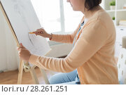 artist with pencil drawing picture at art studio. Стоковое фото, фотограф Syda Productions / Фотобанк Лори