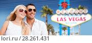 Купить «couple in shades over las vegas sign at summer», фото № 28261431, снято 14 июля 2013 г. (c) Syda Productions / Фотобанк Лори