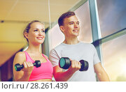 Купить «smiling young woman with personal trainer in gym», фото № 28261439, снято 29 июня 2014 г. (c) Syda Productions / Фотобанк Лори