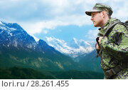 Купить «soldier in military uniform with backpack hiking», фото № 28261455, снято 14 августа 2014 г. (c) Syda Productions / Фотобанк Лори