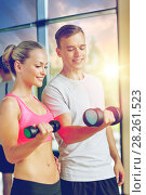 Купить «smiling young woman with personal trainer in gym», фото № 28261523, снято 29 июня 2014 г. (c) Syda Productions / Фотобанк Лори
