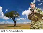 Купить «soldier in military uniform with backpack hiking», фото № 28261527, снято 14 августа 2014 г. (c) Syda Productions / Фотобанк Лори