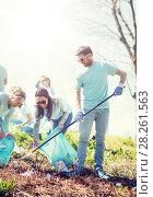 Купить «volunteers with garbage bags cleaning park area», фото № 28261563, снято 7 мая 2016 г. (c) Syda Productions / Фотобанк Лори