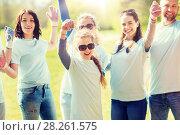 Купить «group of volunteers celebrating success in park», фото № 28261575, снято 7 мая 2016 г. (c) Syda Productions / Фотобанк Лори