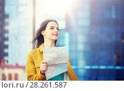 Купить «happy young woman traveling with map in city», фото № 28261587, снято 12 мая 2016 г. (c) Syda Productions / Фотобанк Лори