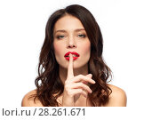 Купить «woman with red lipstick holding finger on mouth», фото № 28261671, снято 5 января 2018 г. (c) Syda Productions / Фотобанк Лори