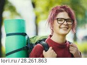 Купить «Portrait of woman hiker in casual clothes with backpack in the park», фото № 28261863, снято 4 июля 2017 г. (c) Константин Шишкин / Фотобанк Лори