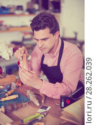 Купить «Carpenter working in studio», фото № 28262039, снято 8 апреля 2017 г. (c) Яков Филимонов / Фотобанк Лори