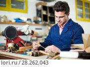 Купить «Carpenter working in studio», фото № 28262043, снято 8 апреля 2017 г. (c) Яков Филимонов / Фотобанк Лори