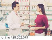 Купить «pharmacist serving woman in pharmacy», фото № 28262079, снято 16 ноября 2019 г. (c) Яков Филимонов / Фотобанк Лори