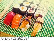 Купить «Sushi set in restaurant», фото № 28262387, снято 23 октября 2019 г. (c) Яков Филимонов / Фотобанк Лори