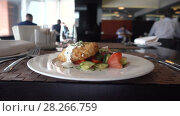 Купить «Business lunch food closeup restaurant business», видеоролик № 28266759, снято 6 апреля 2018 г. (c) Ekaterina Demidova / Фотобанк Лори