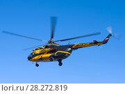 Купить «ST. PETERSBURG, RUSSIA - APRIL 07, 2018: The helicopter Mi-8TV (RA-24100) of the airline Alliance Avia AON flying in the blue sky», фото № 28272819, снято 7 апреля 2018 г. (c) Виктор Карасев / Фотобанк Лори