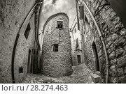 Купить «Old narrow street view of medieval Girona. Catalonia, northeastern Spain», фото № 28274463, снято 15 октября 2018 г. (c) Сергей Цепек / Фотобанк Лори