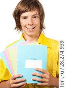 Купить «Мальчик подросток держит в руках разноцветные тетради», эксклюзивное фото № 28274939, снято 28 июля 2010 г. (c) Давид Мзареулян / Фотобанк Лори