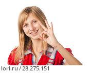 """Купить «Веселая девушка с брекетами показывает знак """"ОК!""""», эксклюзивное фото № 28275151, снято 12 сентября 2010 г. (c) Давид Мзареулян / Фотобанк Лори"""